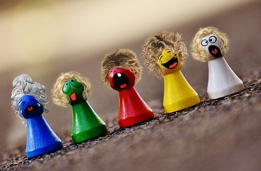 Coloured pegs with different faces
